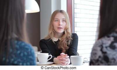 Young girl sitting and talking, good for job interviews and...