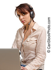 Young girl sitting at a desk wearing a headset