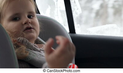 Young girl sitting in car seat