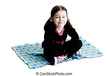 Young girl sitting on a b