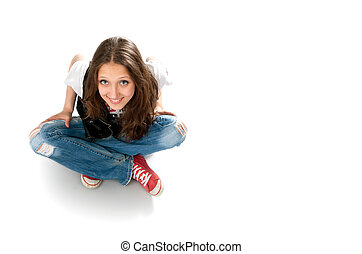 young girl sitting on a floor