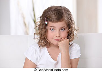 Young girl sitting on a sofa
