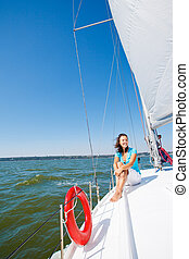Young girl sitting on a yacht