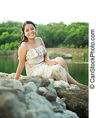 girl sitting on rocks