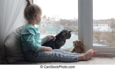 Young girl sitting with cat