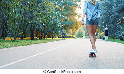 Young girl skating in the park