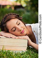 girl sleep on books