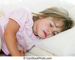 Young Girl Sleeping In Her Bed