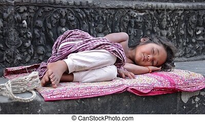 young girl sleeping on an altar - young girl sleeping in...