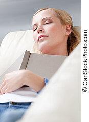 Young girl sleeps with book