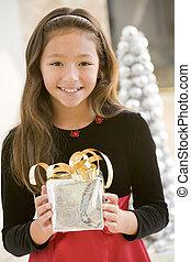 Young Girl Smiling, Holding Christmas Gift