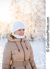 Young girl smiling in winter