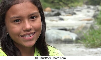 Young Girl Smiling near River
