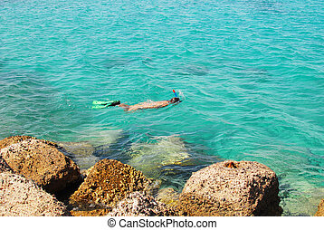 young girl snorkelling in the sea