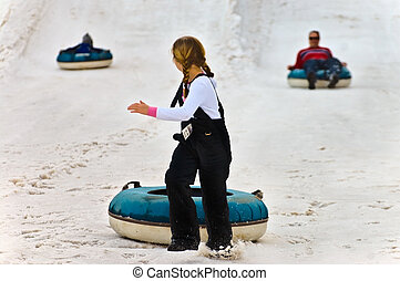 Young Girl Snow Tubing