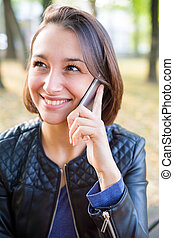 Young girl speaking on the mobile phone face portrait