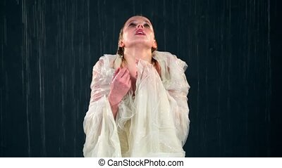 Young girl stands under water jets and trembles - Young girl...