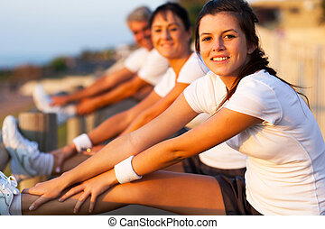 young girl stretching her leg before exercise - young girl...