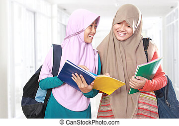 Two young girl student study together in school