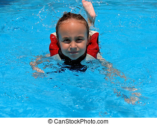 Young girl swimming in the pool.