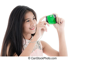 Young girl taking a picture with a small camera on a white background