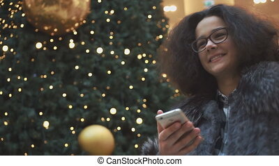 Young girl talking and looking into the phone