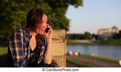Young girl talking on a cell phone