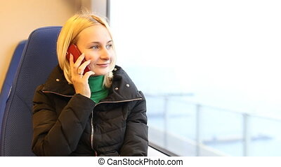 Young girl talking on mobile cell phone smiling, outdoors.  Happy Woman