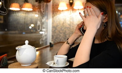 Young girl talking on the phone in
