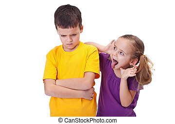 Young girl teasing and mocking a boy