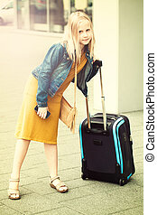 Young girl teen with suitcase at airport