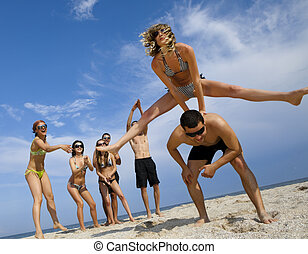 Young girl to jump across her boyfriend against joyful team...