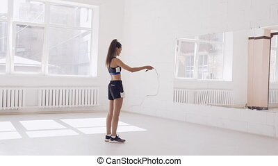 Young girl training with a rope in the hall - Footage was ...