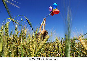 young girl tries to fly away on balloons