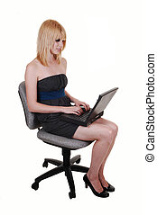 Young girl typing on laptop.