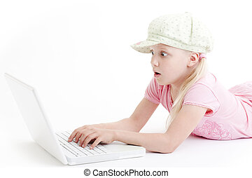 young girl using a laptop computer
