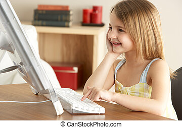 Young Girl Using Computer At Home