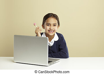 Young girl using laptop