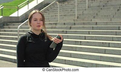 Young Girl Using Smartphone Outside