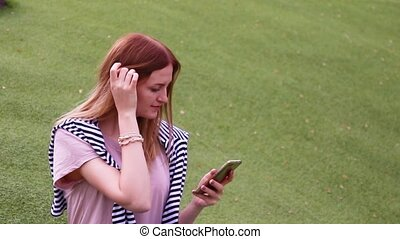 Young girl using smartphone voice recognition, dictation...