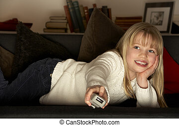 Young Girl Using Television Remote Control