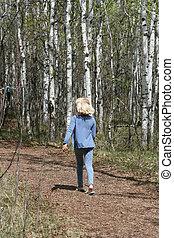 Young Girl Walking Down a Path