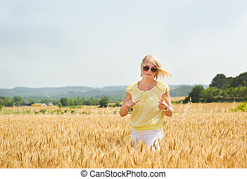 Young girl walking in the field