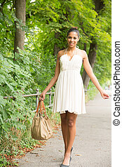 Young Girl walking in the park