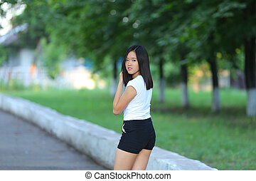 Young girl walking in the park are gait