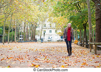 Young girl walking on a fall day