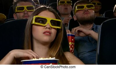 Young girl watching movie at cinema 3D: thriller, Close up -...