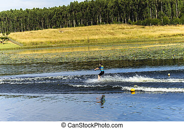 Young Girl Water-Skiing Landscape