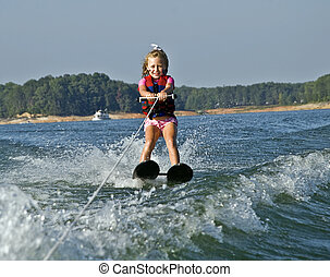 Young Girl Waterskiing - A young girl skiing, she's having a...