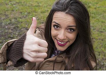 young girl waving